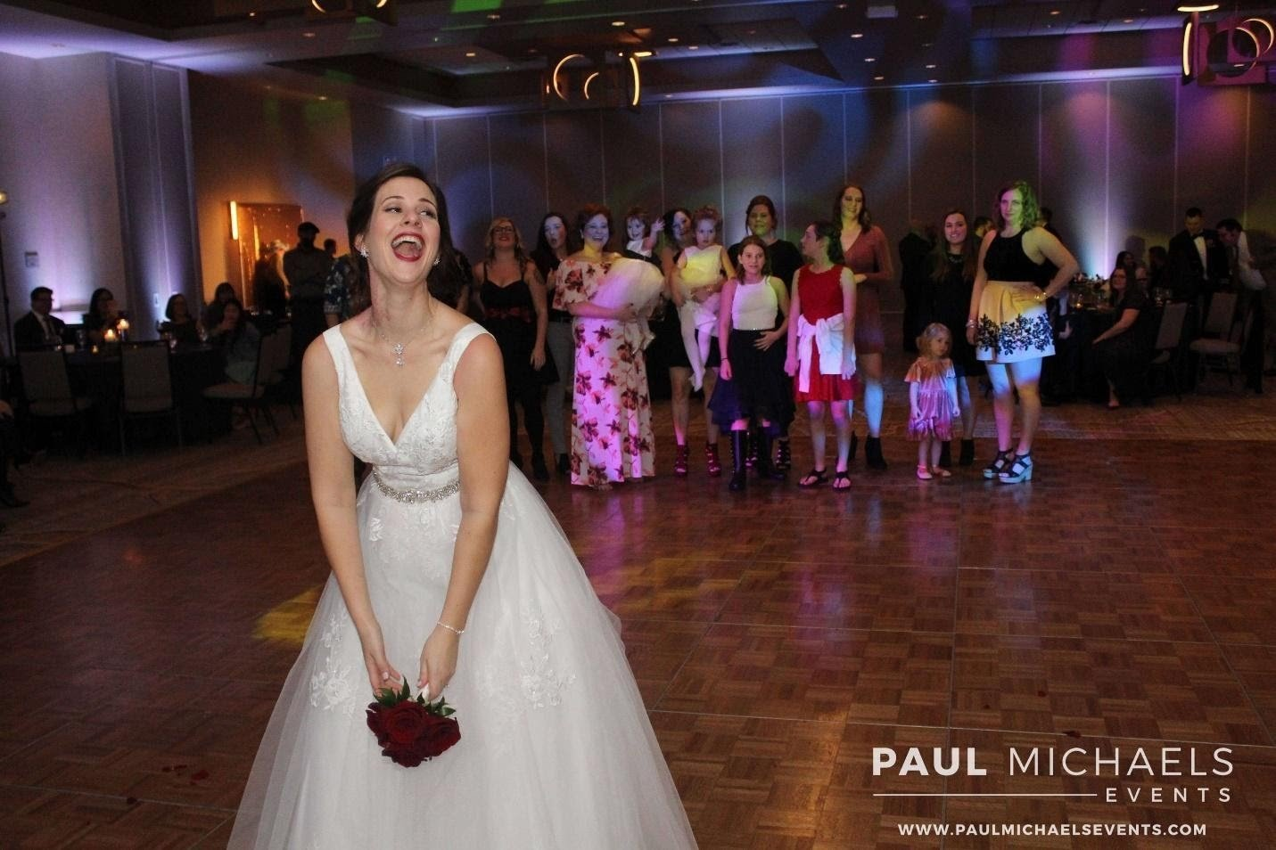 Chicago bride tossing her bouquet