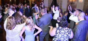 Guests dancing at a wedding reception